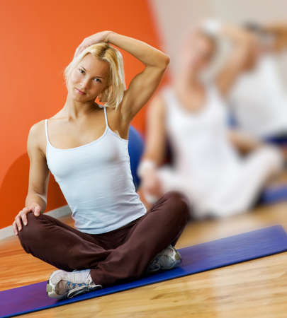 Group of people doing yoga exercise Stock Photo - 4410743