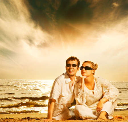 Young beautiful couple in love on the beach photo
