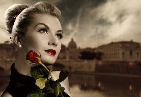 potrait: Beautiful young woman with red rose. Retro potrait Stock Photo