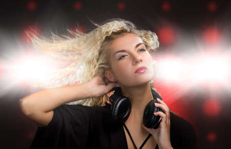 Beautiful young woman with headphones in nightclub Stock Photo - 4438686