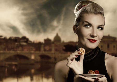 Beautiful young woman eating chocolate. Retro potrait
