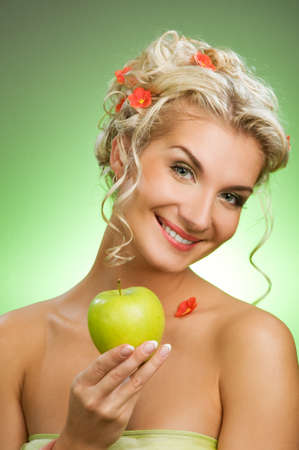 Beautiful young woman with ripe green apple Stock Photo - 4450480