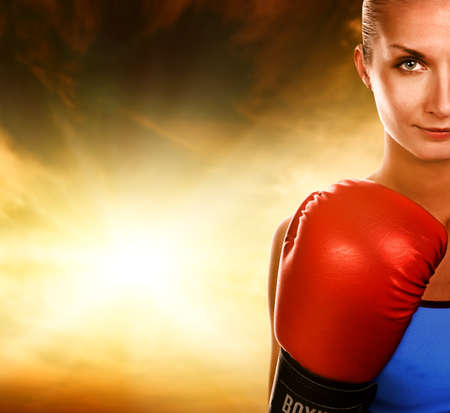 boxer: Beautiful woman with red boxing gloves