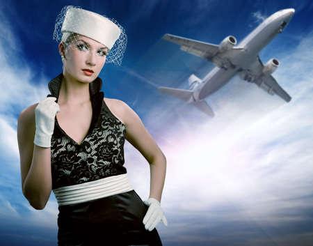 Sexy hostess di volo e aereo Archivio Fotografico - 4475927