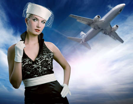 Sexy stewardess and flying plane photo