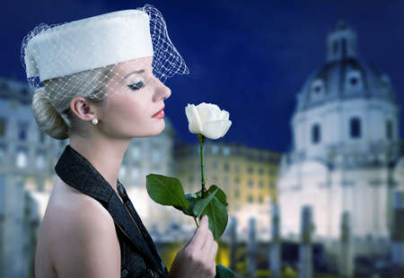 Beautiful young woman with white rose. Retro portrait Stock Photo