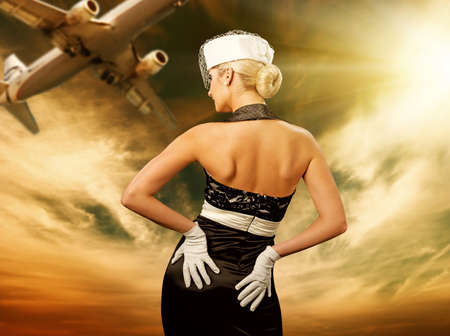 airplane girl: Sexy stewardess and flying plane Stock Photo