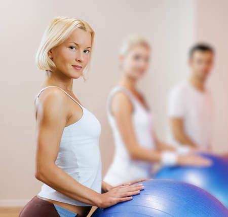 Group of people doing fitness exercise with a ball Stock Photo - 4478446