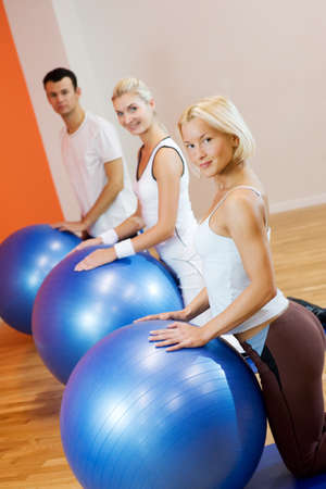 Group of people doing fitness exercise with a bal Stock Photo - 4478443