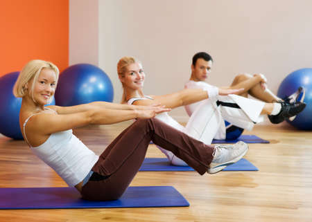 Group of people doing fitness exercise with a ball photo