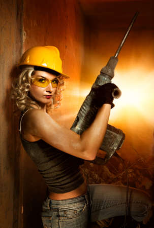 Beautiful blond woman with heavy perforator in her hands Stock Photo - 4501249