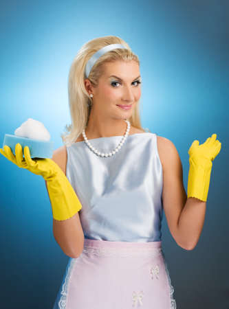 rubber gloves: Beautiful happy housewife. Retro portrait Stock Photo
