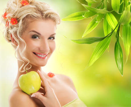 Beautiful young woman with ripe green apple Stock Photo - 4519756