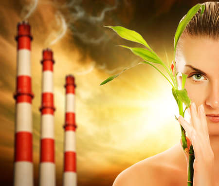 Young woman with green plant. Global warming concept Stock Photo - 4519749