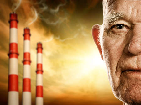 global retirement: Elderly mans face. Power plants on background