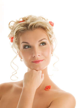 Beautiful young woman with fresh spring flowers in her hair close-up portrait photo