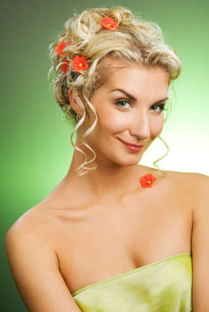 Beautiful young woman with fresh spring flowers in her hair. Spring concept. Stock Photo - 4537101