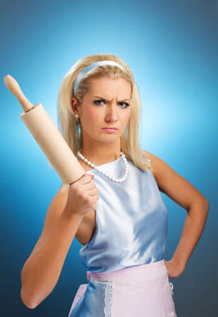 rolling pin: Angry housewife with rolling pin Stock Photo
