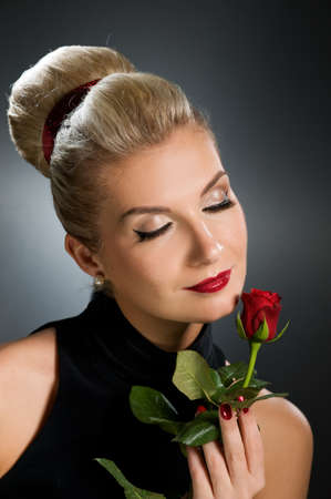Charming lady with red rose photo
