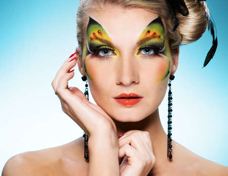 Young beauty with butterfly face-art Stock Photo - 4561547