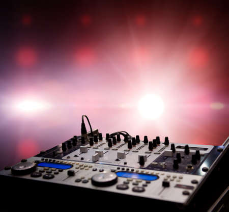 audio mixer: Dj mixer over abstract background Stock Photo