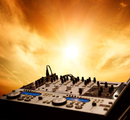 audio mixer: Dj mixer over sky background
