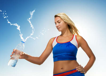 Young woman drinking water after fitness exercise Stock Photo - 4609567