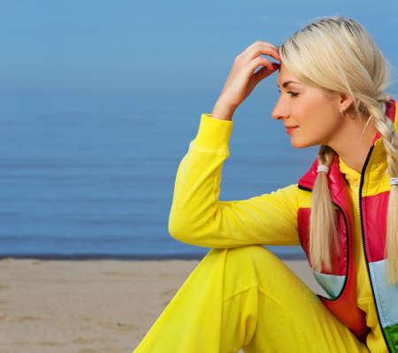 Beautiful young woman relaxing near the sea Stock Photo - 4609617