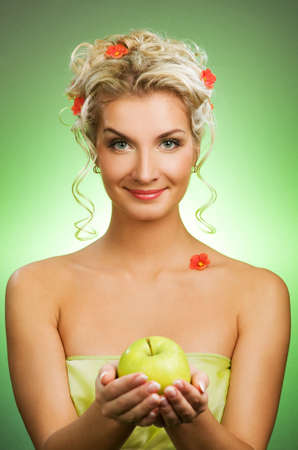 Beautiful young woman with ripe green apple Stock Photo - 4641571
