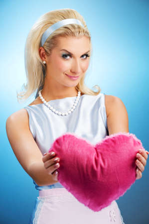 Beautiful young woman with fluffy heart pillow Stock Photo - 4641603