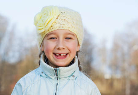 Happy toothless girl outdoors photo
