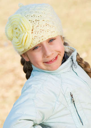 Funny little girl outdoor photo