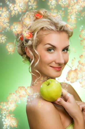 Beautiful young woman with ripe green apple Stock Photo - 4668643