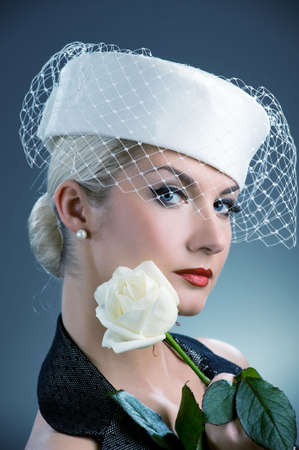 Beautiful young woman with white rose photo