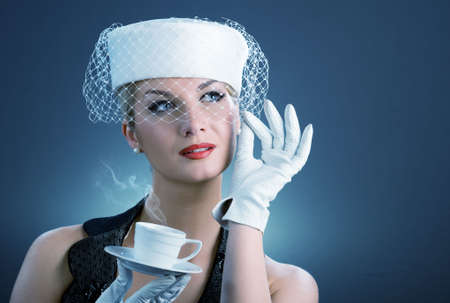 Lovely lady with coffee cup photo