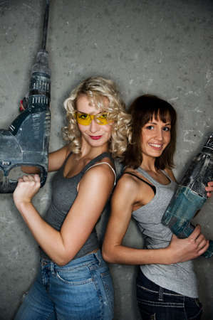 Two beautiful women with heavy perforators photo