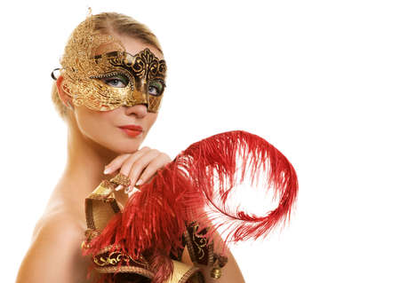 Beautiful young woman with carnival mask on her face photo