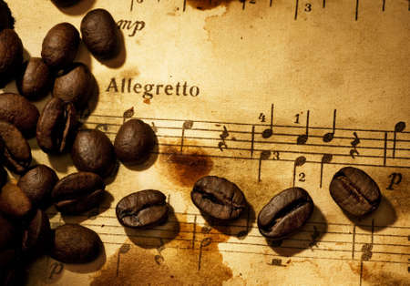 Coffee beans on a grungy musical background photo