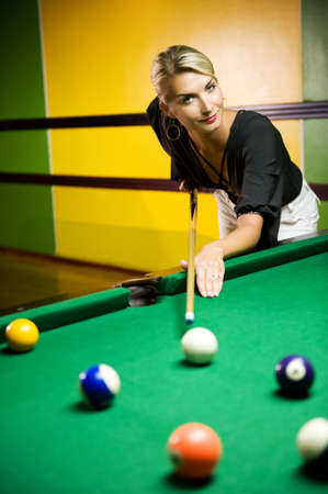 snooker tables: Beautiful blond woman playing billiards Stock Photo
