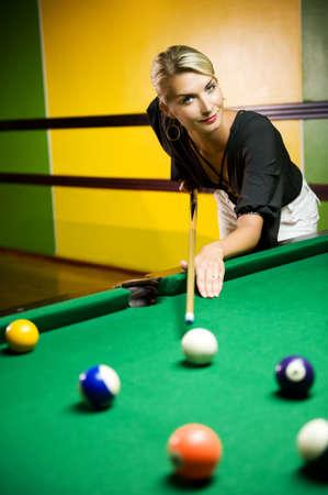 snooker balls: Beautiful blond woman playing billiards Stock Photo