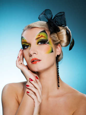 faceart: Young beauty with butterfly face-art