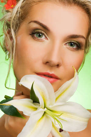 Beautiful young woman with lily flower. Close-up portrait Stock Photo - 4770113