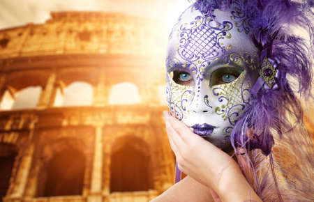 Beautiful woman in front of Colosseum (Rome, Italy) photo