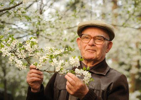 Happy elderly man in a garden Stock Photo
