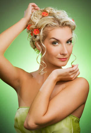 Beautiful young woman with flowers in her hair Stock Photo - 4818812