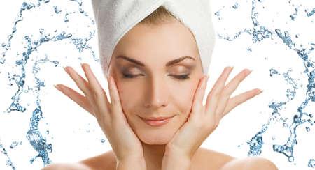 Beautiful young woman washing her face Stock Photo - 4837531