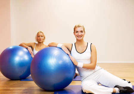 Group of people doing fitness exercise with a ball Stock Photo - 4930216