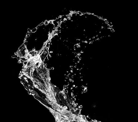 falling water: Stylish water splash. Isolated on black background