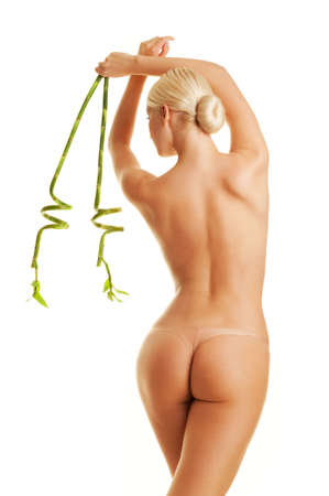 nude woman back: Beautiful young woman with green bamboo leaves