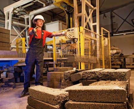 Factory worker throwing defective block photo